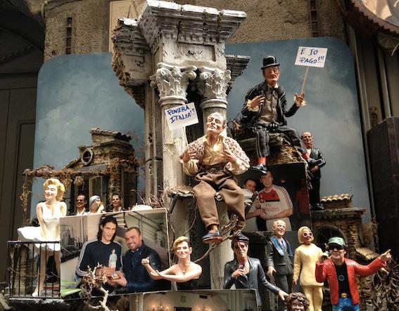 View of presepe merchandise on sale in Via S. Gregorio Armeno, including figurines of Totò and Eduardo De Filippo, the singers Adriano Celentano and Vasco Rossi, the footballer Edinson Cavani, and Marilyn Monroe.