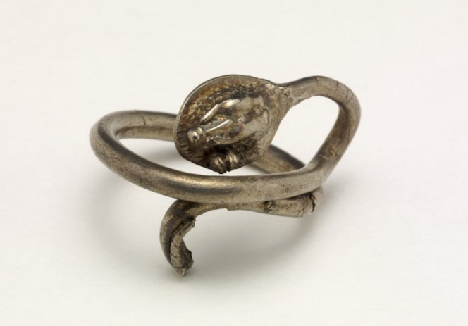Fig. 3: Silver snake finger-ring, possibly re-used as a votive offering. From the Backworth Hoard (Romano-British). British Museum, inv. no. 1850, 0601.11.