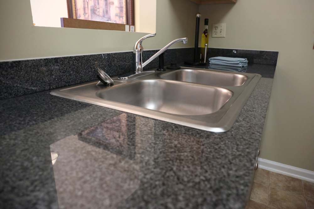 All apartments feature black granite countertops in kitchens and bathrooms.