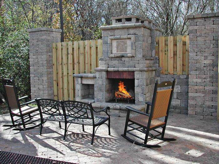 Apartment community amenities include stacked stone outdoor fireplace and grilling areas.