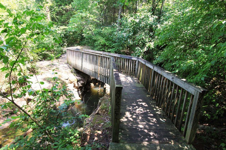 "Take a stroll along the jogging trails and walk ""over the [creek] and through the woods."""