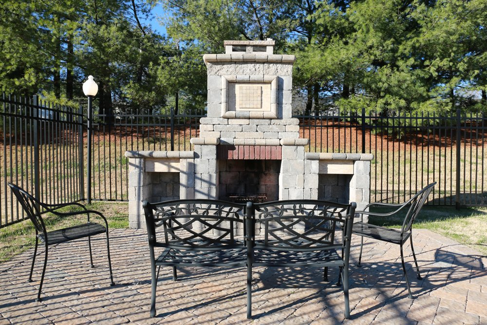 Three outdoor stone fireplaces and grill areas are located on our apartment home community property for residents to enjoy.