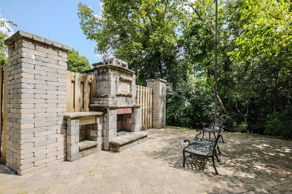 Outdoor stone fireplaces and BBQ areas are available to residents as gathering and cooking areas.