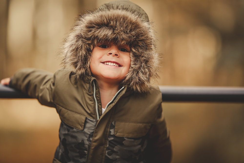 a little boy's eskimo grin...