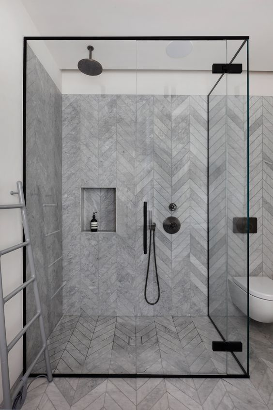 Black Trim On The Glass Shower Doors And Black Hardware In The Shower.