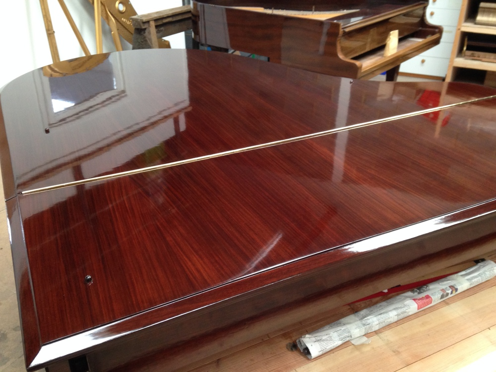 See how the beauty of the rosewood is enhanced by traditional French Polishing!
