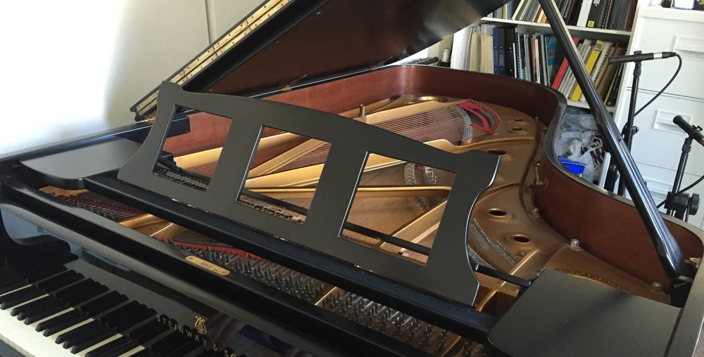 We make custom music desks (such as the one above) for your piano. The square holes allow the sound to be better projected without removing the desk; it makes a big difference to the pianist's impression of tone compared to using a standard solid desk. We advise keeping the original desk for re-fitting in case you sell the piano.