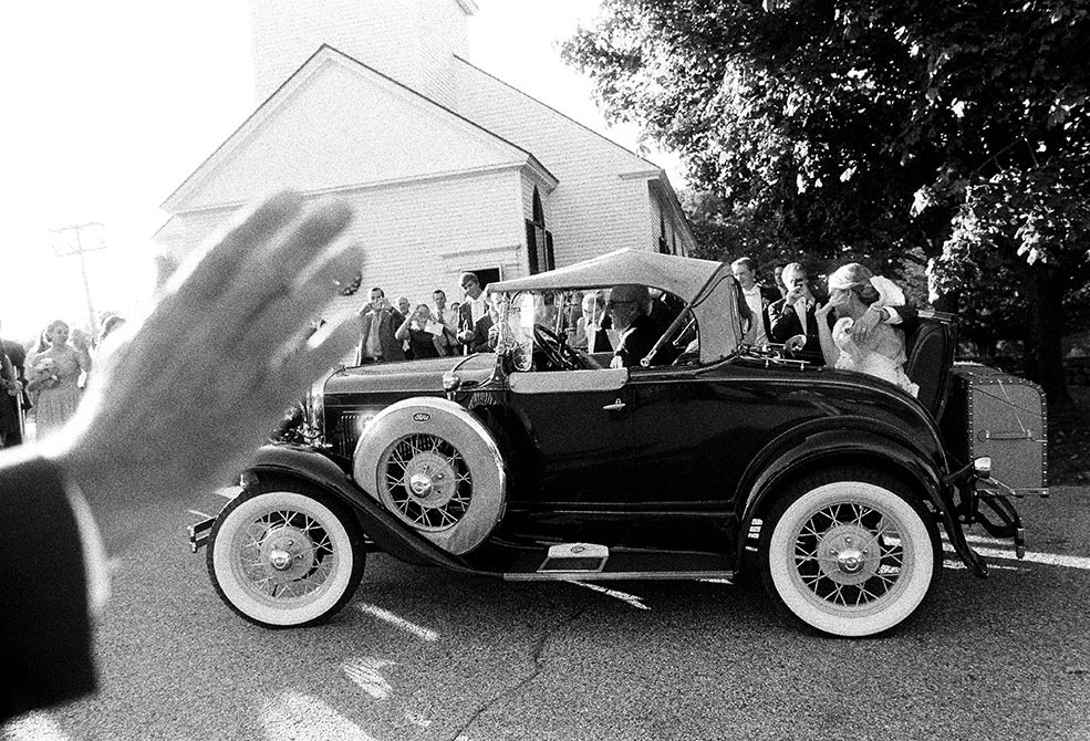 vintage car getaway after church ceremony
