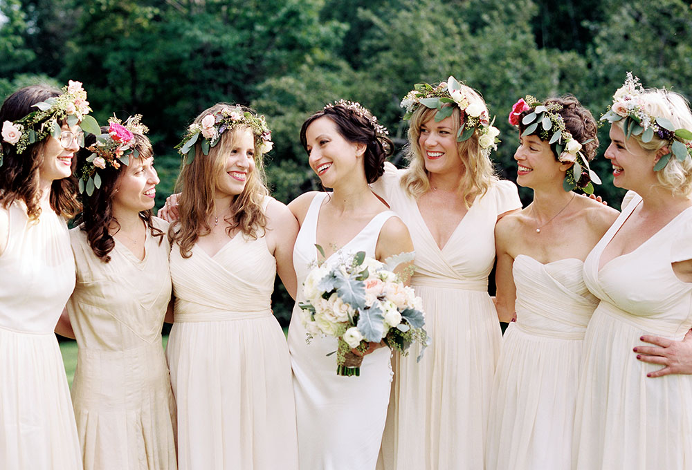 backyard wedding with floral crowns