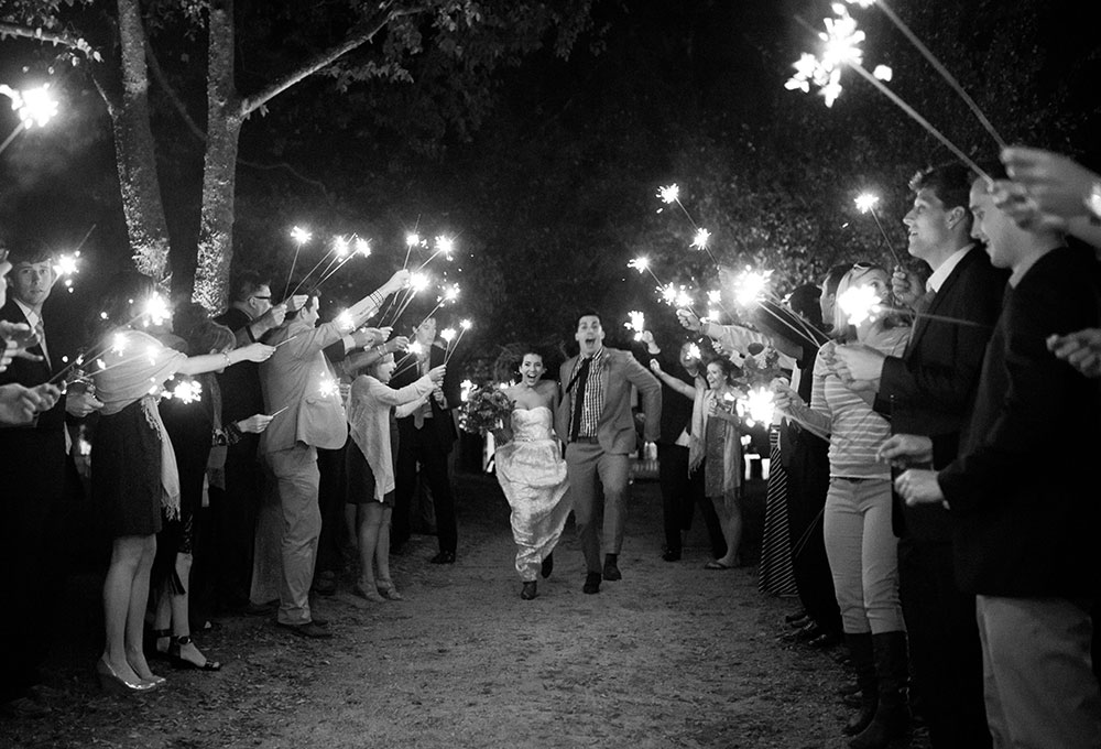 Sparkler exit with couple wearing cowboy boots