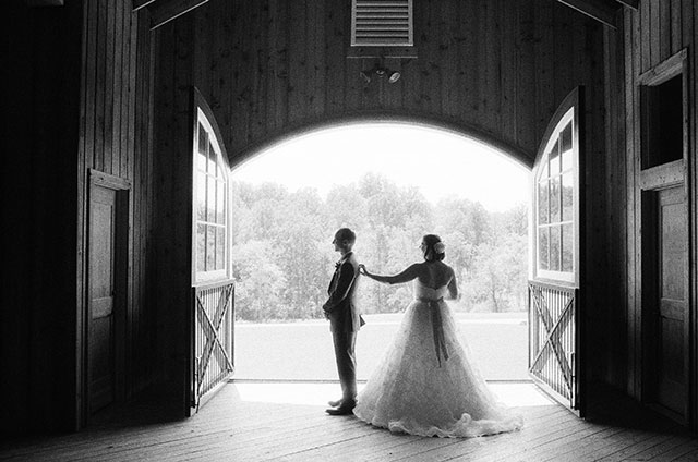 first look in rustic barn with bride and groom