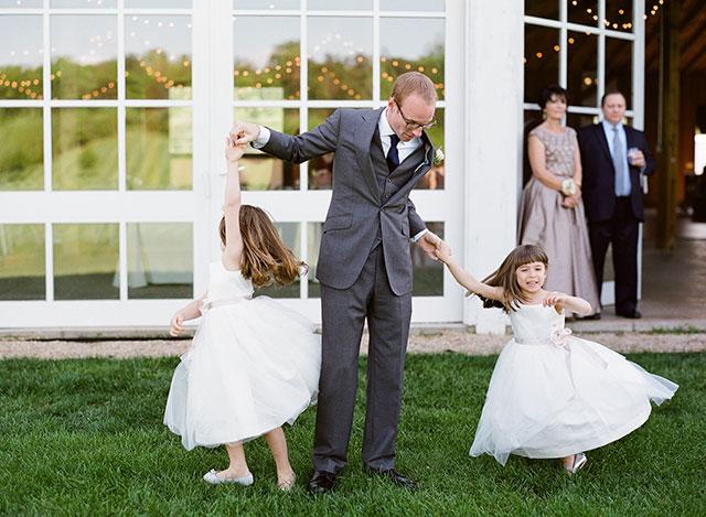 flower girls dancing at wedding ceremony