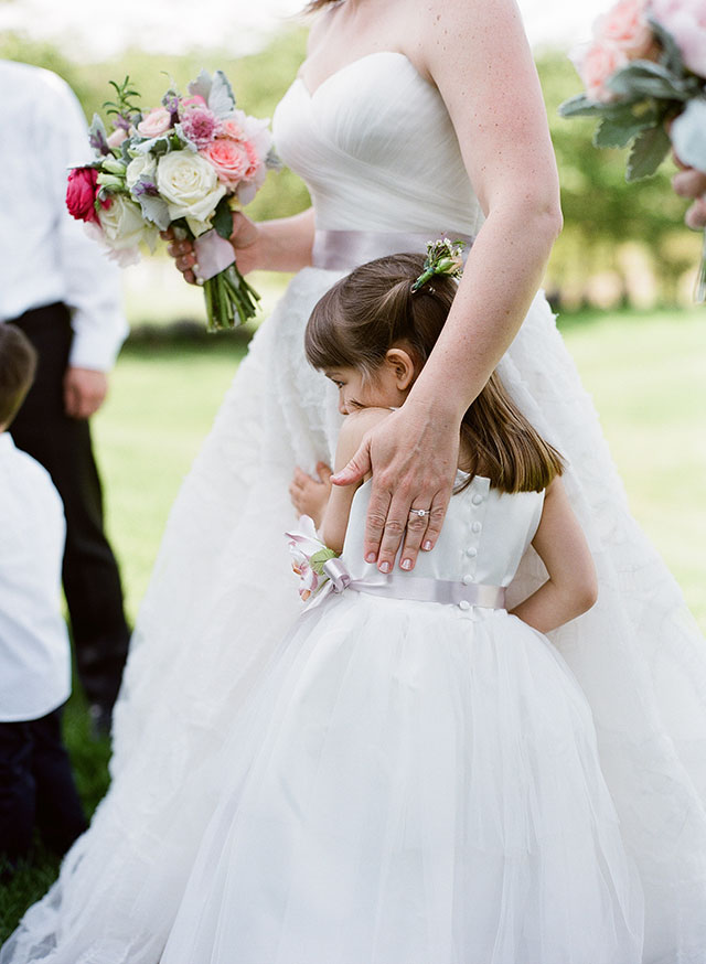 bride hugs flower girl