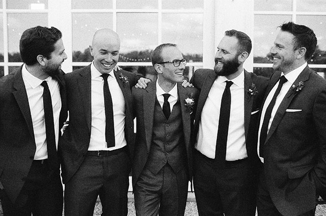 portrait of groom and groomsmen on black and white film