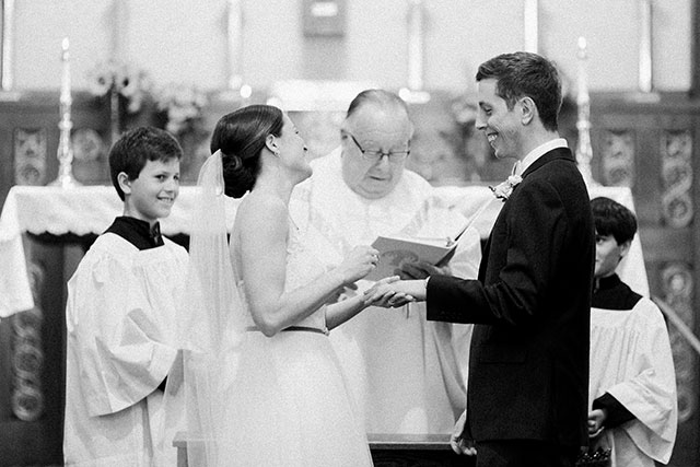 Exchange of rings during church ceremony - Sarah Der Photography