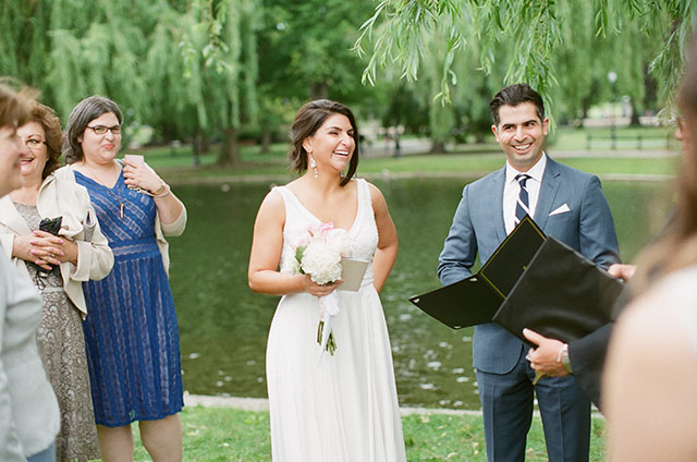 bride and groom smile after being declared husband and wife - Sarah Der Photography