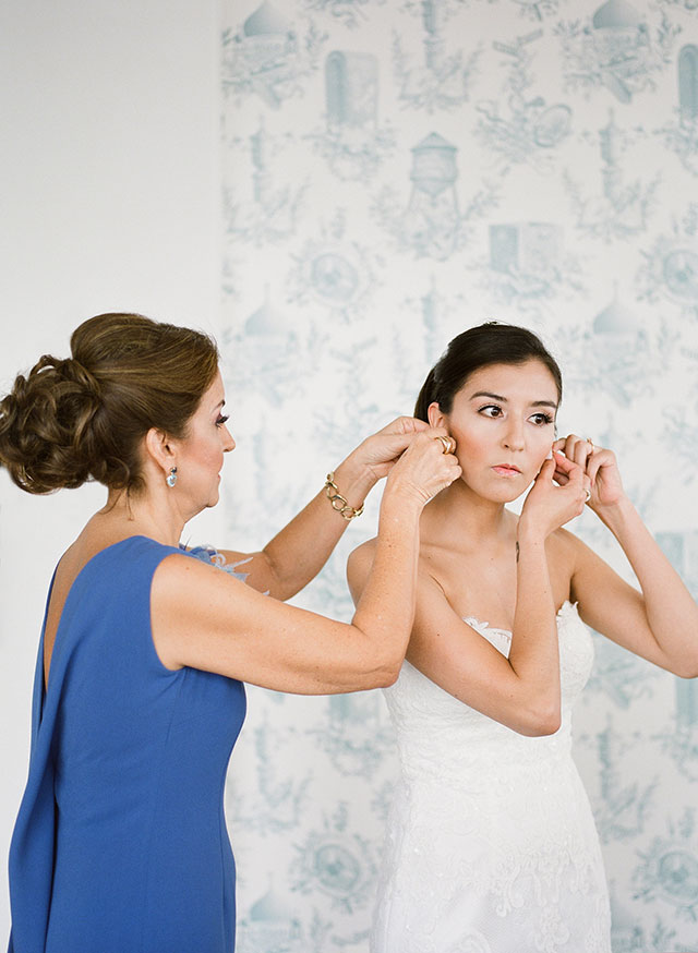 Mother of bride helps her put on her earrings