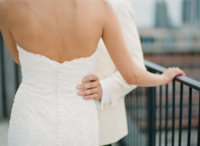 Rooftop wedding photo of couples new wedding bands - Sarah Der Photography