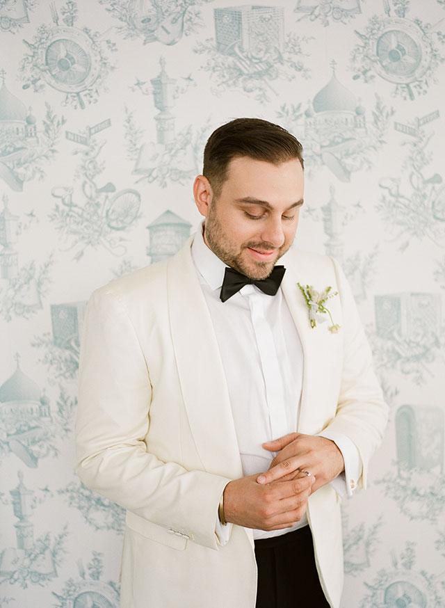 Dapper groom attire with white tuxedo jacket - Sarah Der Photography