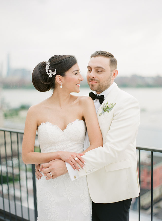 Rooftop wedding portraits at the Wythe Hotel with Manhattan skyline in background