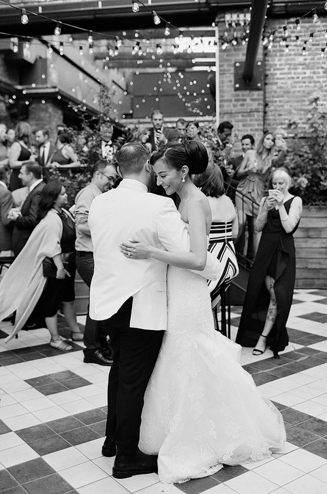 Timeless wedding day photo of bride and groom sharing first dance - Sarah Der Photography