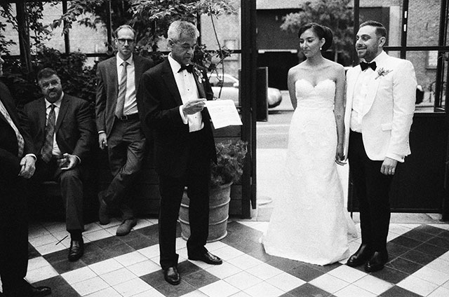 Outdoor reception venue in NYC toasts on the terrace - Sarah Der Photography