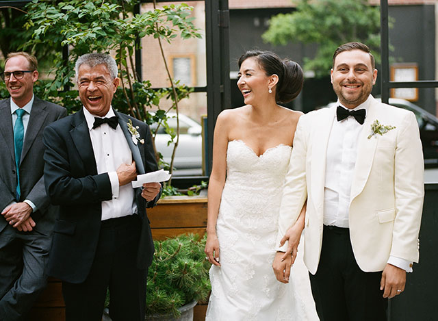 Sincere image of bride and groom laughing during toasts - Sarah Der Photography