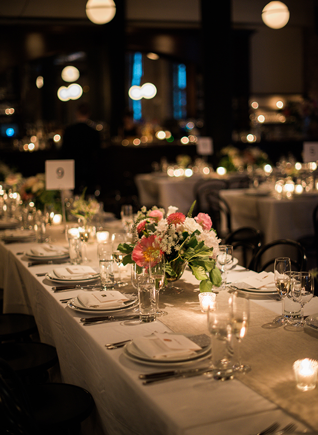 Intimate reception setting with candles and beautiful floral design - Sarah Der Photography