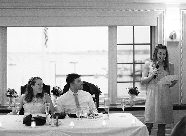 black and white reception photo of bride and groom listening to toasts - Sarah Der Photography