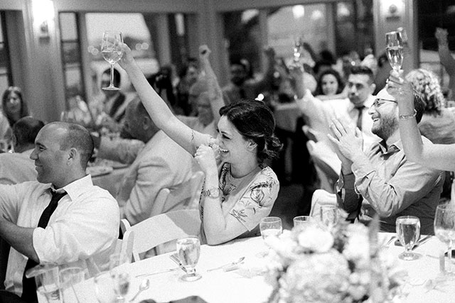 guests cheers toast - Sarah Der Photography
