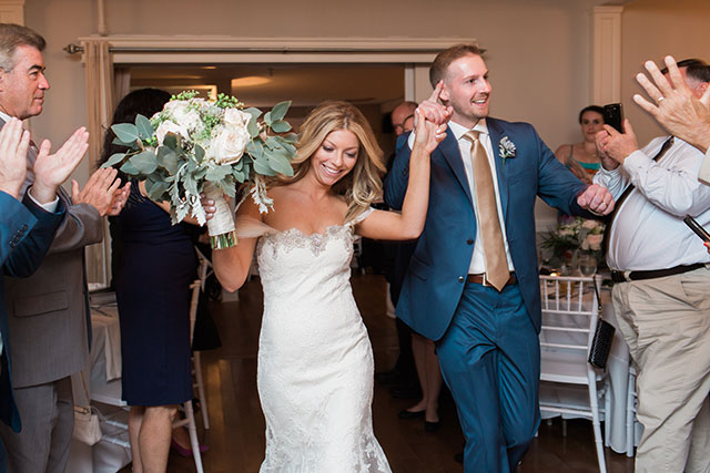 bride and groom celebrate at reception - Sarah Der Photography