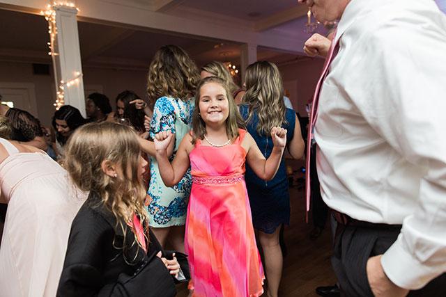 little girl dances at wedding - Sarah Der Photography