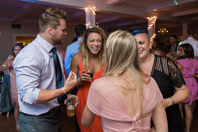 guests dancing and having fun at reception - Sarah Der Photography