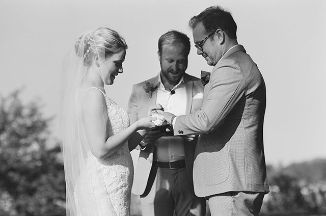 fine art wedding photography of bride and groom exchanging rings - Sarah Der Photography