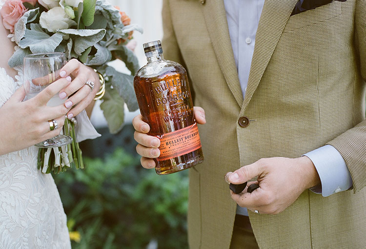 digging up the wedding day bourbon - Sarah Der Photography