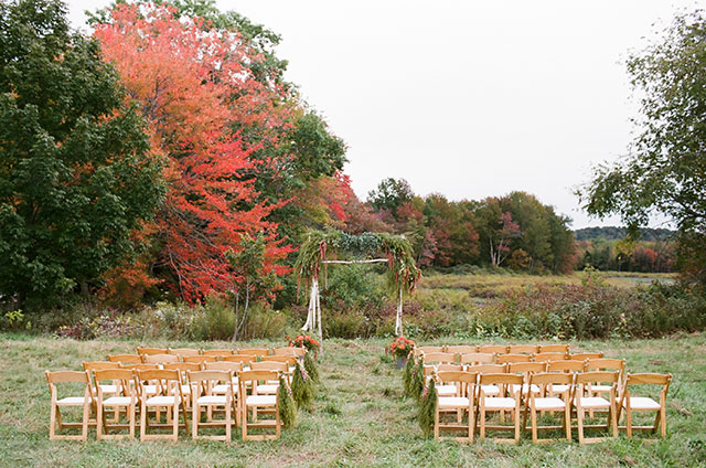 fall wedding in northern maine ceremony site with chairs and autumn trees - Sarah Der Photography