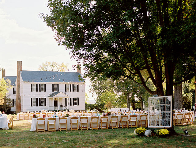 Outdoor plein air reception at Tuckahoe Plantation with string lights and family style dinner