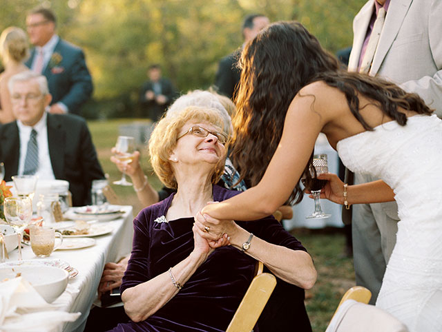 Candid wedding photo of bride with her grandmother