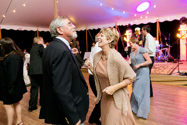Candid photo of guests dancing at reception, music played by Three Sheets to the Wind