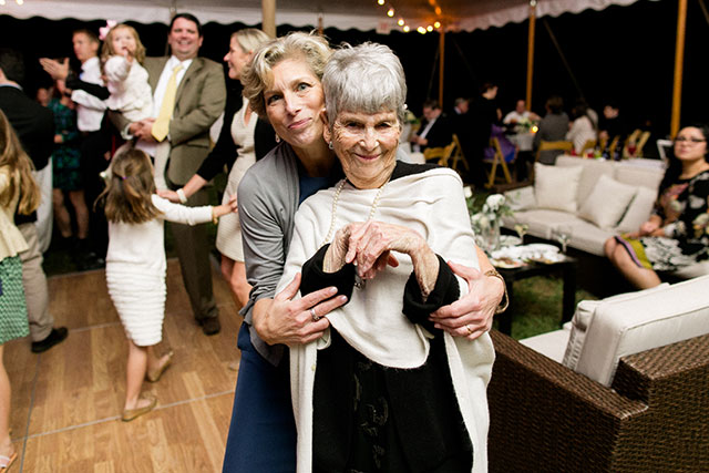 Sweet photo of mother and grandmother at wedding reception