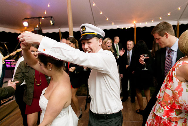 Groom wears sailor hat for reception dancing photos