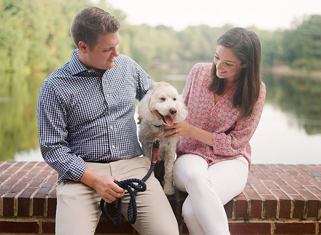 Portrait at the lake of university of richmond with labradoodle puppy