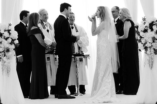 bride sips from jewish wine vessel