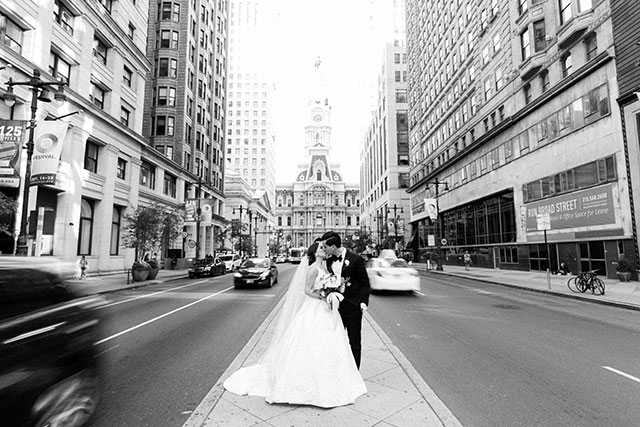 Black and white image of couple in front of capital building in downtown