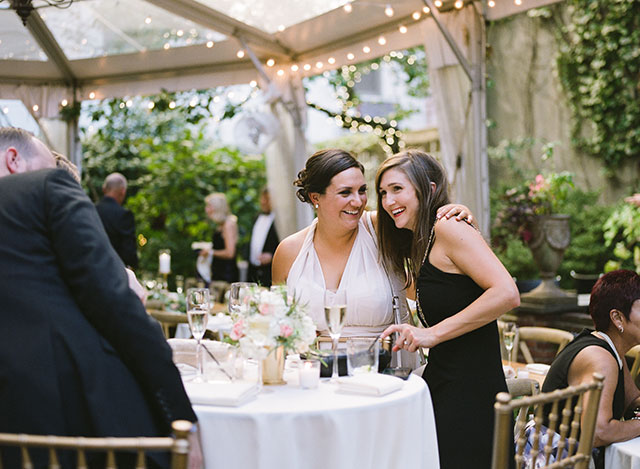 Two guests laughing at at outdoor garden reception