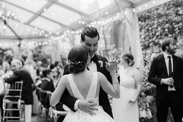 Outdoor reception with string lights, shot on black and white film, by film wedding photographer Sarah Der