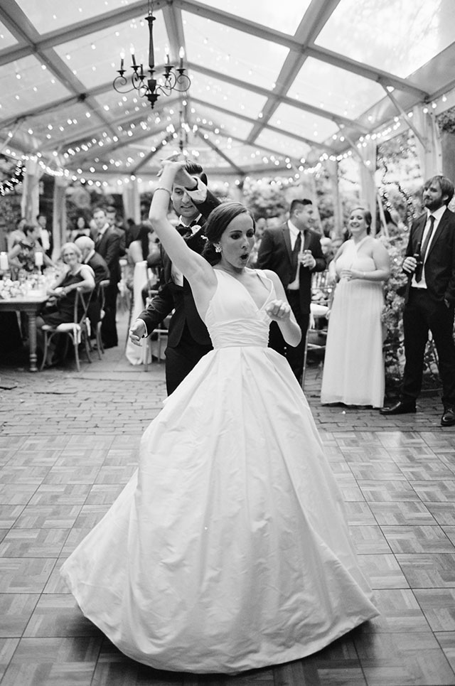 Classic film wedding photo of couple dancing