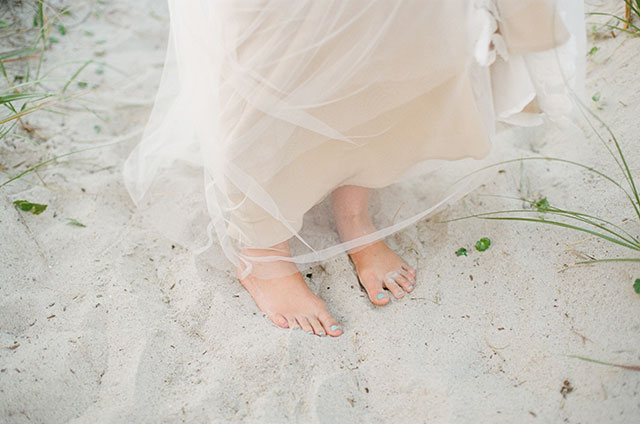 bride's barefoot toes in the sand!