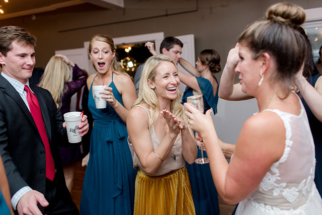 guests laugh as bride dances