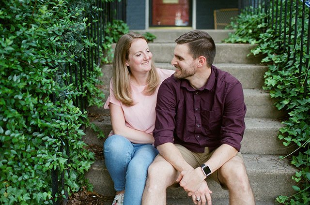 couple laughing on front steps  - Sarah Der Photography